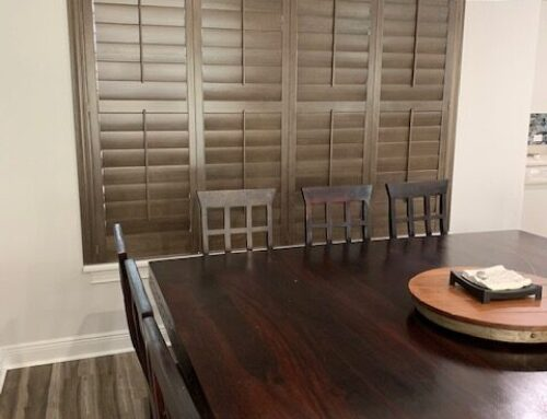 "Wood stained plantation shutters 4 1/2"" vanes with crown z frames."